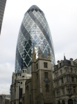 Gherkin building in the financial district. I especially love this picture because you can see the difference between the old-style London with its old classic buildings and the modern London with all its steel, glass, and industry.